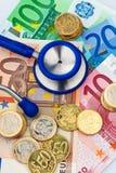 Nota dell'euro dieci e dello stetoscopio Fotografia Stock