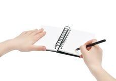 Nota delle mani, della matita e di libro Fotografia Stock