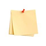 Nota di carta gialla con il perno rosso Fotografia Stock