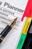 Nota di programma e penna di fontana Immagini Stock