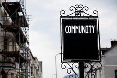 Nota di scrittura che mostra Comunità Foto di affari che montra l'annata del gruppo di unità di Alliance di affiliazione dello st Immagine Stock