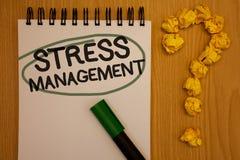 Nota di scrittura che mostra gestione dello stress Foto di affari che montra la putrefazione del blocco note di sanità di positiv Immagine Stock