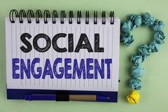 Nota di scrittura che mostra impegno sociale La foto di affari che montra la posta ottiene l'alto writte di SEO Advertising Marke Immagini Stock Libere da Diritti
