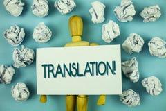 Nota di scrittura che mostra a traduzione chiamata motivazionale Montrare della foto di affari trasforma le parole o i testi ad u Immagine Stock