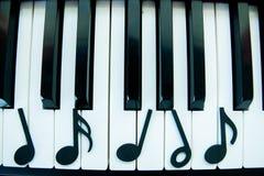 Nota do piano imagens de stock