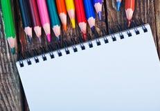 Nota e lápis Fotografia de Stock