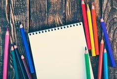 Nota e lápis Imagens de Stock