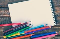 Nota e lápis Fotos de Stock