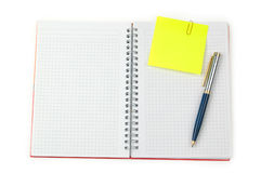 Nota e penna su un taccuino Immagini Stock