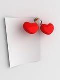 Nota en blanco de los corazones rojos Foto de archivo libre de regalías