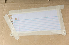 Nota en blanco sobre la cartulina Imágenes de archivo libres de regalías