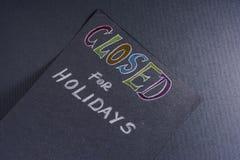Nota para cerrado el días de fiesta Foto de archivo