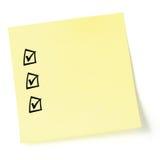 Nota pegajosa aislada que enumera tick-boxes negros Fotos de archivo libres de regalías