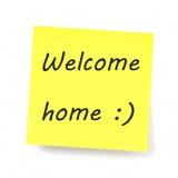 Nota pegajosa amarela - casa bem-vinda Fotos de Stock