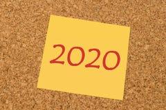 Nota pegajosa amarilla - Año Nuevo 2020 Fotografía de archivo