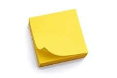 Nota pegajosa amarilla en blanco Imágenes de archivo libres de regalías