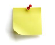 Nota pegajosa amarilla en blanco Foto de archivo libre de regalías