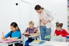 Nota's van schoolkinderen Stock Foto's