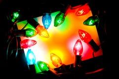 Nota-tarjeta de la luz de la Navidad Foto de archivo libre de regalías