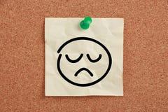 Nota triste de la cara Imagen de archivo libre de regalías