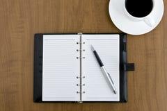 Nota y café fotos de archivo libres de regalías