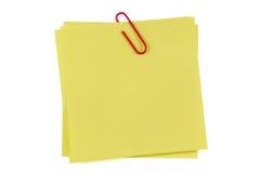 Nota y clip de post-it Fotos de archivo libres de regalías