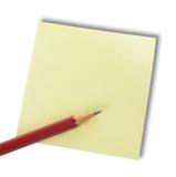 Nota y lápiz Foto de archivo libre de regalías