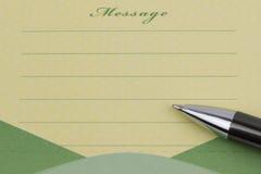 Nota y pluma pegajosas del mensaje fotografía de archivo