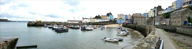 Tenby (Welsh: Dinbych-y-pysgod, meaning fortlet of the fish) is a walled seaside town in Pembrokeshire, Wales, Royalty Free Stock Photo