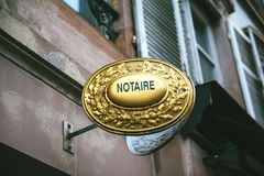 Notaire sign. Notaire sing on wall above entrance to the notary office royalty free stock photography
