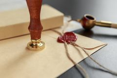 Notarial wax seal on tied scrolled documents, closeup. Notarial wax seal on tied scrolled documents Stock Photo