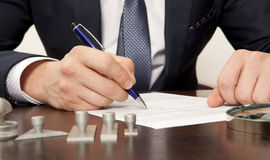 Notary. Lawyer, notary signs the documents from our office stock images