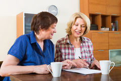 Notary officer helping aged client Stock Image