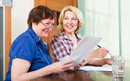 Notary officer helping aged client Royalty Free Stock Photography