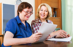 Notary officer helping aged client Royalty Free Stock Image