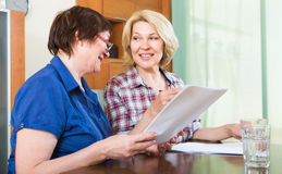 Notary officer helping mature client Stock Photos