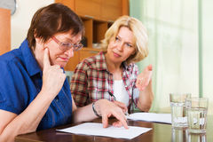 Notary officer helping mature client Royalty Free Stock Photos