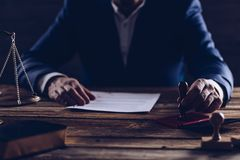Notary public or judge reading testament stock images