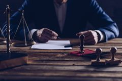Notary public notarizes document in his office. Law concept stock photography
