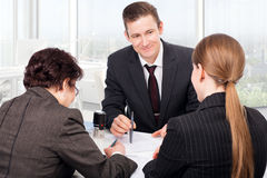 At notary public office. Agent or notary public signing documents with customers Royalty Free Stock Images