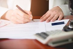 Notary Public signing the contract in her office. Stock Photo