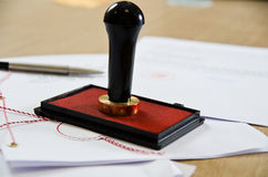 Notary public stamper. Stamp that is used by a notary public and signed document Royalty Free Stock Image