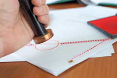 Notary public stamping a document. Notary public stamping an act of attorney stock photo