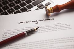 Notary`s public pen and stamp on testament and last will. Notary public tools royalty free stock photo