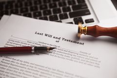 Notary`s public pen and stamp on testament and last will. stock photo