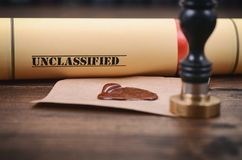 Unclassified document and notary seal on the wooden background. royalty free stock images