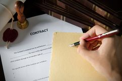 Notary signing a contract with fountain pen in dark room. Notary signing a contract with fountain pen. business man law attorney lawyer notary public Stock Photography