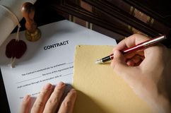 Notary signing a contract with fountain pen. Royalty Free Stock Photography