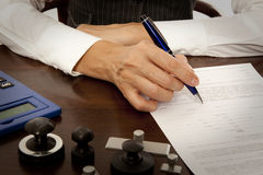 Notary signs the documents in office Stock Photos