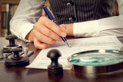 Notary signs the documents in office Royalty Free Stock Photos